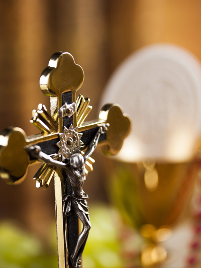 A Crucifix, the Eucharist and Chalice